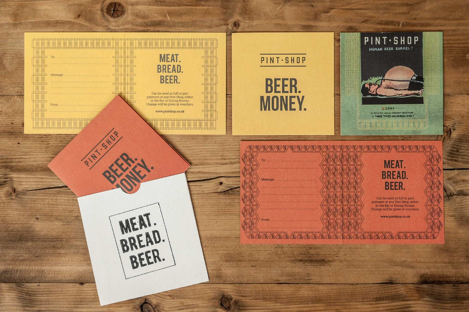Flat lay on a wooden background of various pieces of marketing collateral for Pint Shop, designed by SAINT Design.
