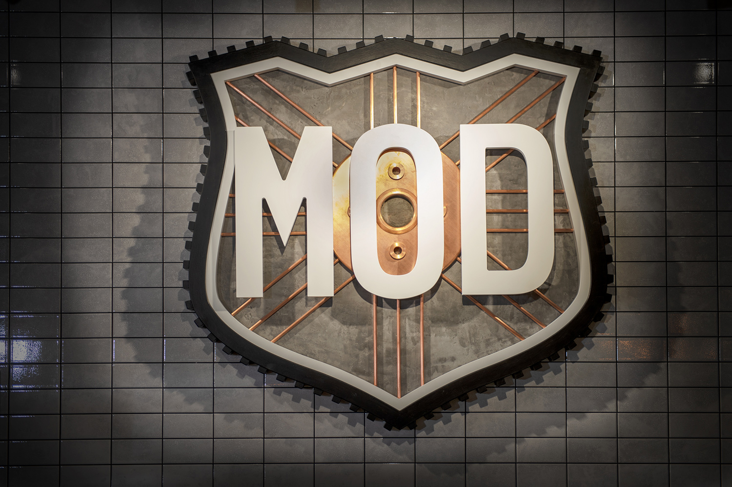A MOD logo made out of tyres and spokes