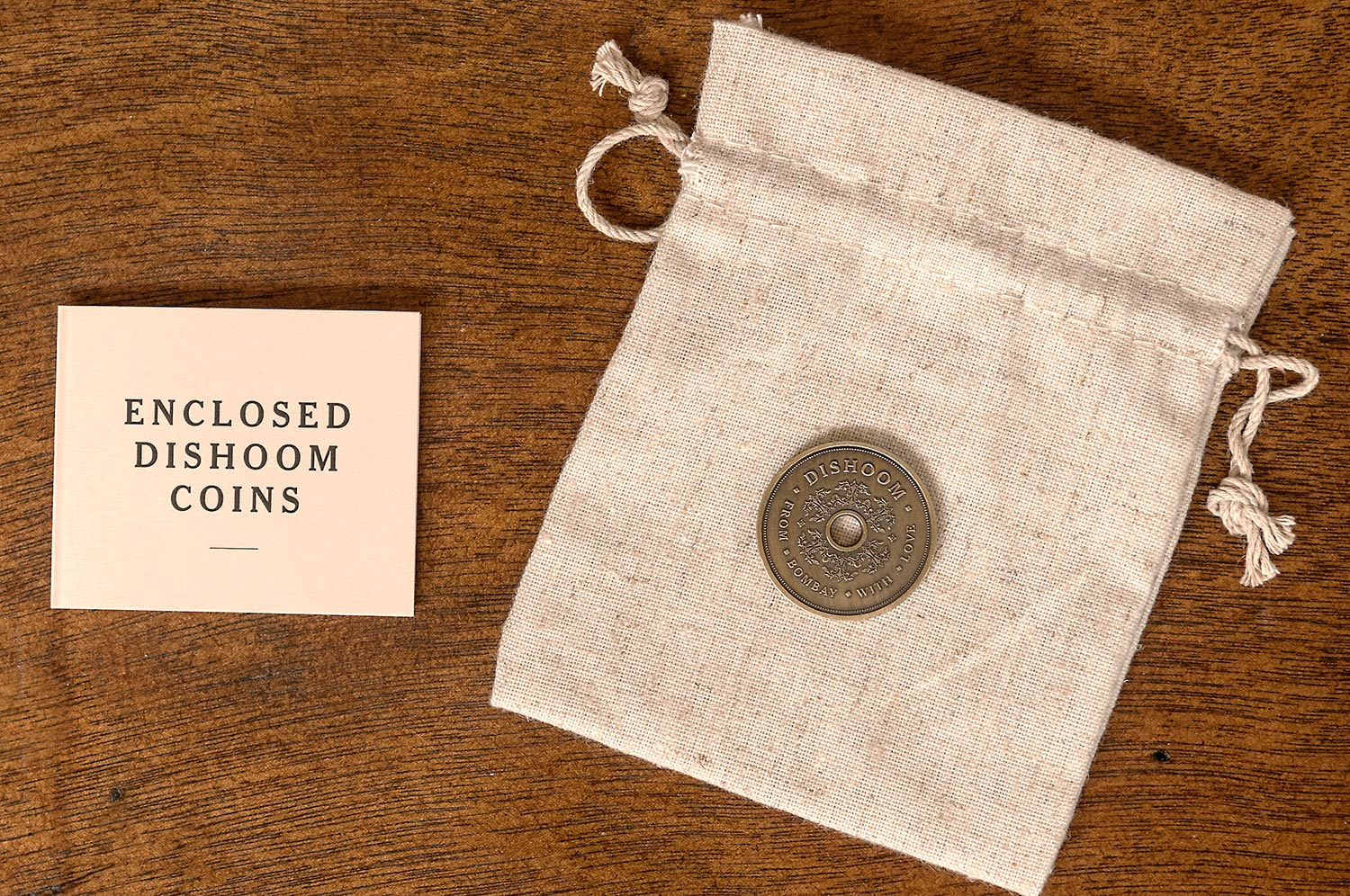 Coin design and marketing collateral for Dishoom by Saint Design