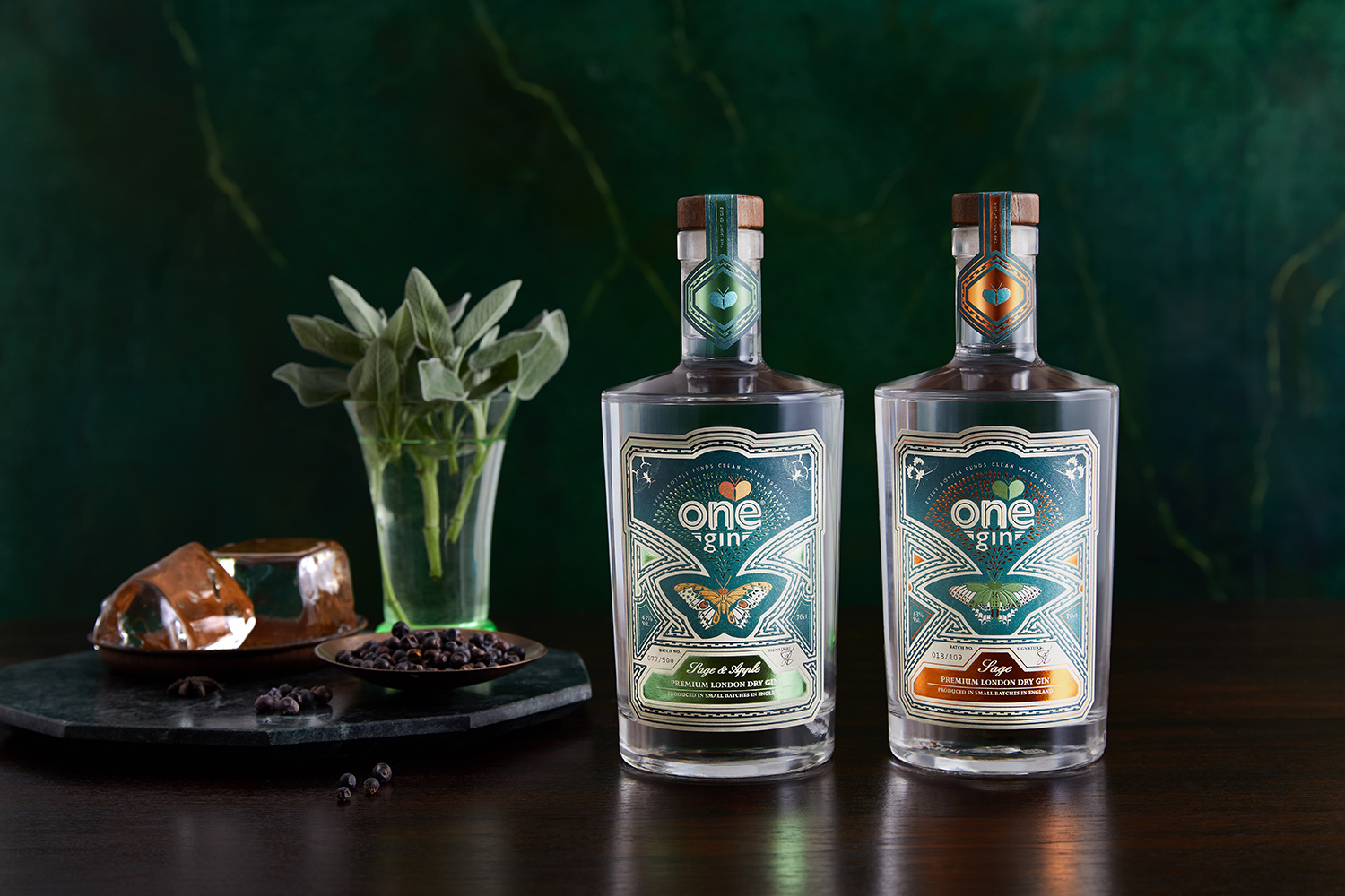 Double shot of Gin bottles with dark stone background