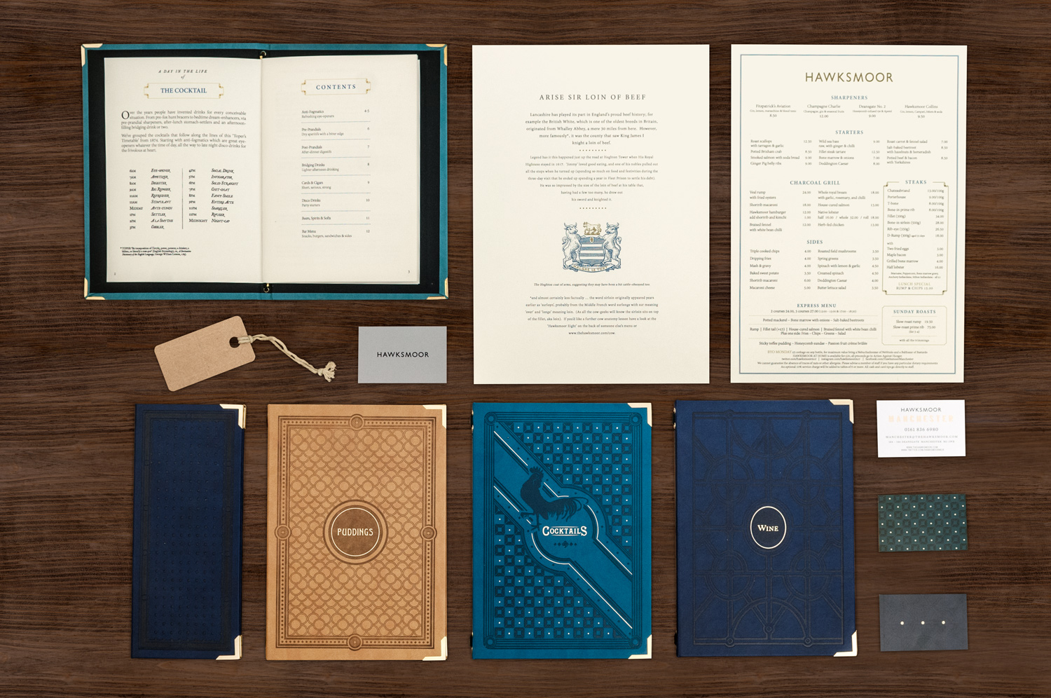 Brand Printed Collateral for Hawksmoor on wood background