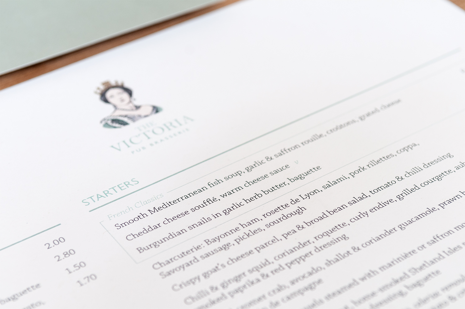 A close up shot of a menu for The Victoria, Oxshott