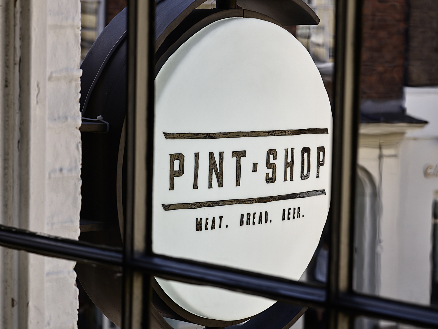 Black and white exterior blade sign for Pint Shop, designed by SAINT Design.